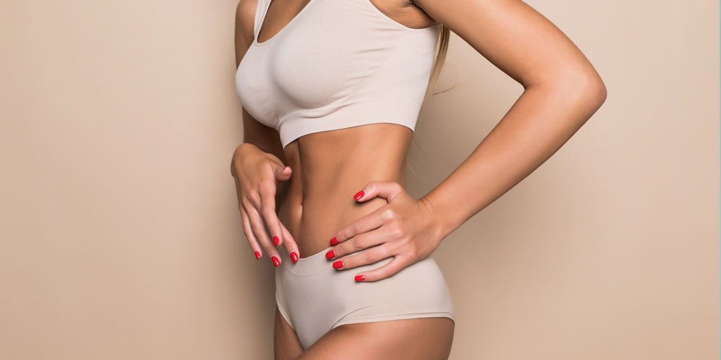 Woman standing in her underwear